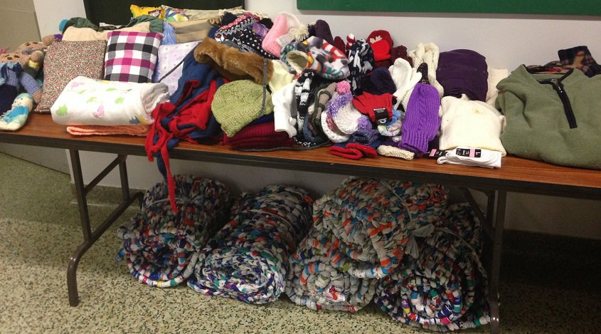 Donated winter clothing, blankets and toys